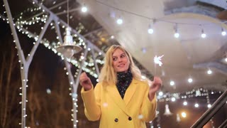 young woman with sparklers on the background of night city