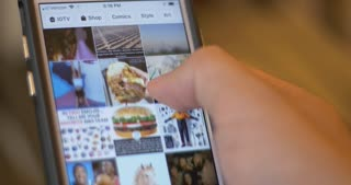 Scrolling Through Pictures On Instagram Social Media App. Food Blog Account In City.