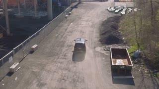 Aerial Slow Motion Behind Black SUV On Dirt Road