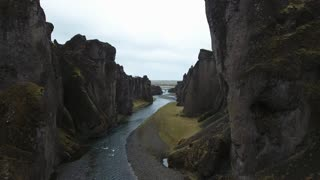 Flying Through Canyon Next To Titanic Walls