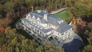 Aerial of A Large Estate Home and Surrounding Property