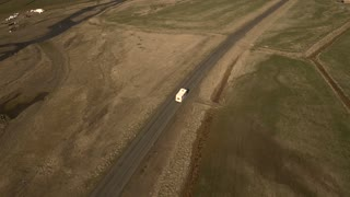 Aerial of an RV Camper Driving Along an Empty Road