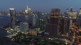 Pan Down Aerial of Jersey City, New Jersey at Night
