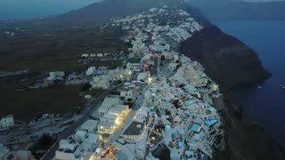Santorini Buildings On Cliffs Aerial Greece 114 Hotels Shops Pools Low Clouds Night Shot Above Clouds