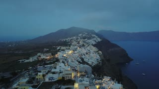 Santorini Buildings On Cliffs Aerial Greece 115 Hotels Shops Pools Low Clouds Night Shot Above Clouds