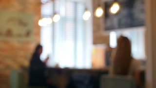 Blur image or defocus of customer in coffee shop, time-lapse movie clip with cinema or vintage effect