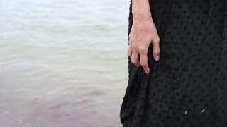 Hands of a wet beautiful girl on the beach