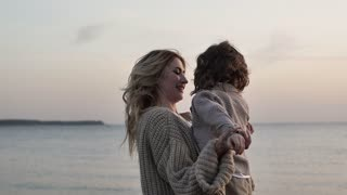 Little boy with mother near the sea