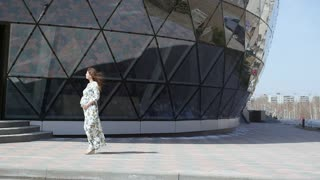 Pregnant girl walking, slowmotion