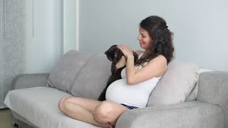 Pregnant girl with cat, slowmotion