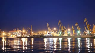 4K Timelapse, cargo ship moving load at port of Odessa. Night Time lapse
