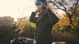 a man motorcyclist wears a helmet and ride on his motorcycle