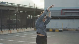 Attractive beautiful young woman riding roller skating and dancing in the streets. Urban background, slow motion 120fps