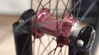 close-up view of the bicycle hub. Rotating bmx or mtb wheel
