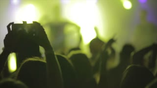 Footage of a crowd partying at a rock concert or dj party  slow motion