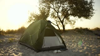 Tent camp during sunset or sunrise on the beach of the island