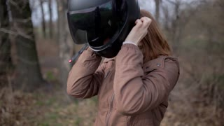 young beautiful woman in motorcycle helmet