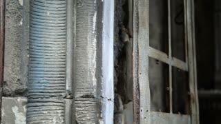 Abandonded crypt with broken rusty door
