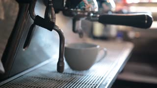 Barista steaming milk to prepare cappuccino