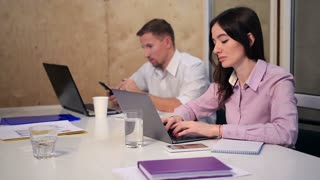 Business colleagues working at desk in the office