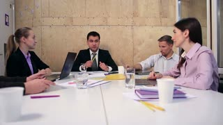Cheerful team of business people in meeting room