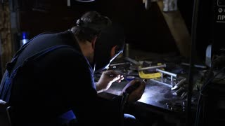 Closeup of man wearing mask welding in workshop