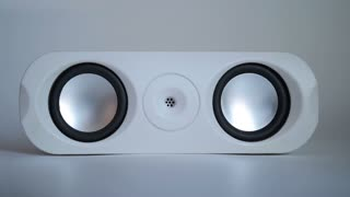 Closeup of set of round audio speakers isolated