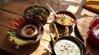 Closeup view of vegetarian food on rustic wooden table