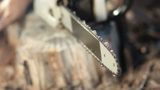 Closeup view of working chainsaw blade