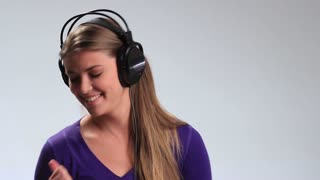 Energy girl with headphones listening to music