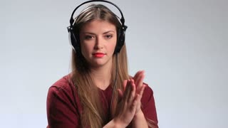 Happy hipster girl going crazy of favorite music