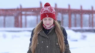 Happy young woman enjoying first snow