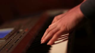 Human hands playing piano atthe party