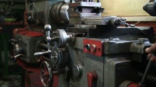 Lathe turning machine getting ready to work