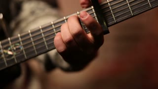 Man playing acoustic guitar close up