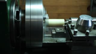 Milling detail on metal cutting machine tool