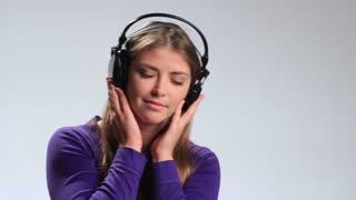 Sensual woman listening music in headphones