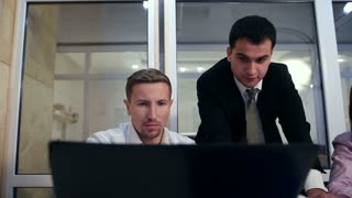 Serious businessman explaining plan to colleagues