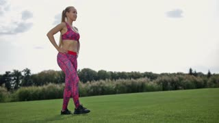 Slim athletic woman doing frontal lunge and squats