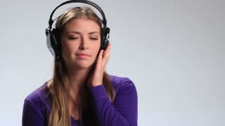 Smiling girl in headphones listening mp3 player