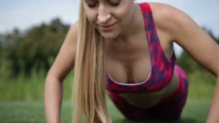 Sporty fit woman exercising by doing push-ups