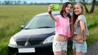 Two cute women making selfies on roadtrip
