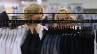 Beautiful elderly women shopping trendy clothes