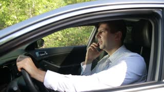 Busy bussinessman arguing on phone in car