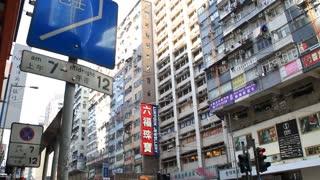 Busy city people on zebra crossing in Hong Kong
