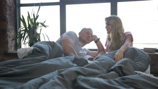 Carefree family enjoying in bed in the morning