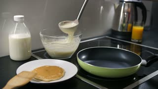 Pouring pancake batter in pan stock video footage videoblocks close up of cooking pankaces on the stove hand pouring pancake batter into the ccuart Images