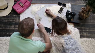 Couple planning new journey with travel map
