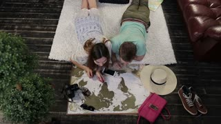 Couple scratching visitited countries on world map