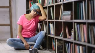 Depressed woman after failing exam in library